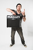 Portrait of guitarist Michael Paget of Welsh heavy metal group Bullet For My Valentine photographed with a Peavey amp backstage at Download Festival...