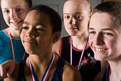 Portrait of gymnastics team with medals