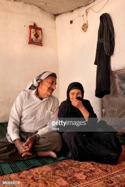 Portrait of Haji Hamad Omar and his wife Hamin Rashid Khadar Born in 1945 Haji Hamad Omar was forced to flee Sakran with his family and they all...