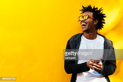 Portrait of handsome afro man using his mobile. : Foto de stock