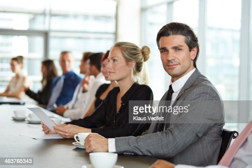 Portrait of handsome businessman at meeting : Stock Photo