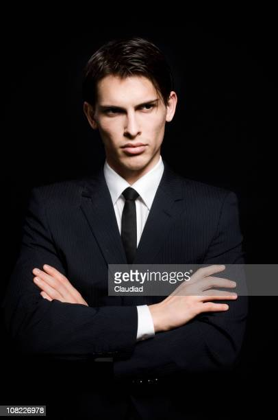 Portrait of Handsome Young Man Wearing Suit, On Black Background