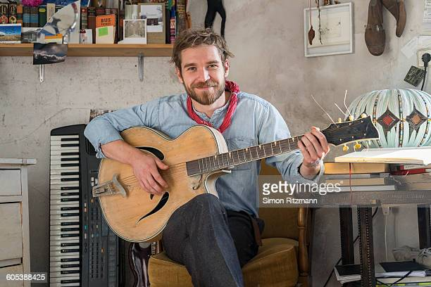 Portrait of handsome young man with guitar