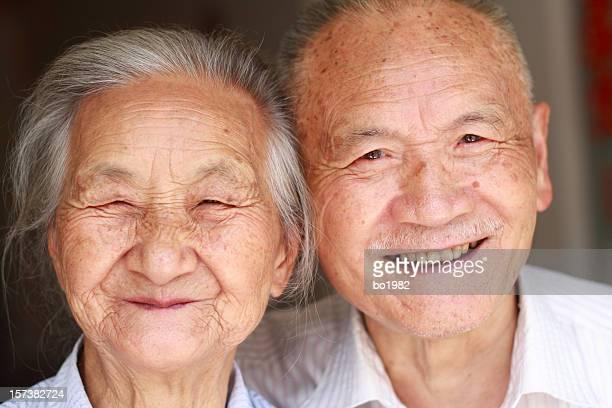 portrait of happy asian senior couple