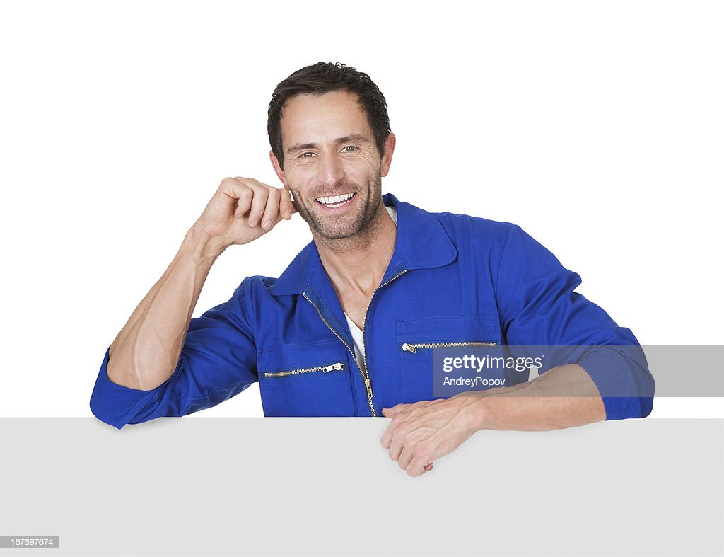 Portrait of happy automechanic : Stockfoto