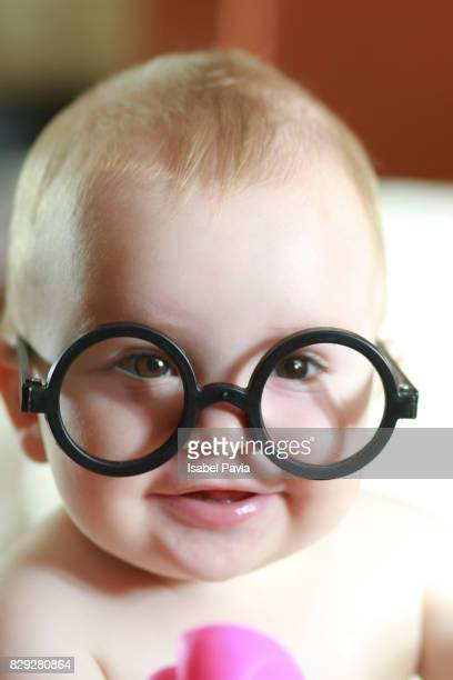 Portrait of happy baby boy with glasses
