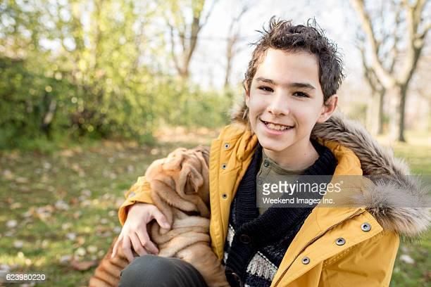 Portrait of happy boy with puppy
