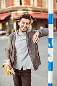 Portrait of happy businessman standing on city street