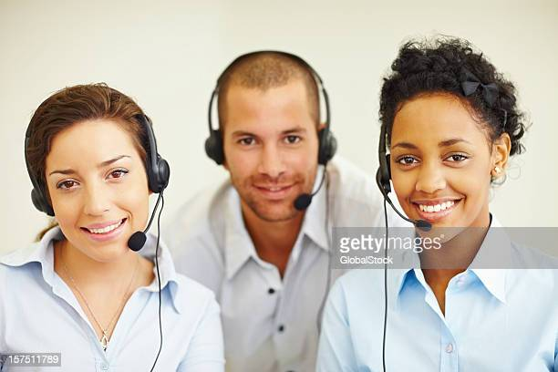 Portrait of happy call center employees