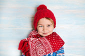 Portrait of happy Christmas boy in red hat