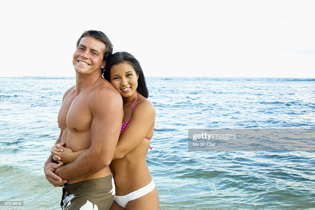 Portrait of happy couple embracing at the beach : Stock Photo