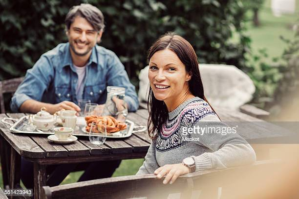 Portrait of happy couple having breakfast at organic farm