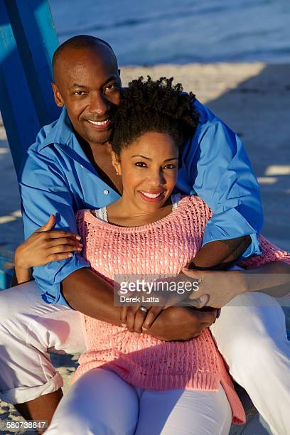Portrait of happy couple hugging on beach