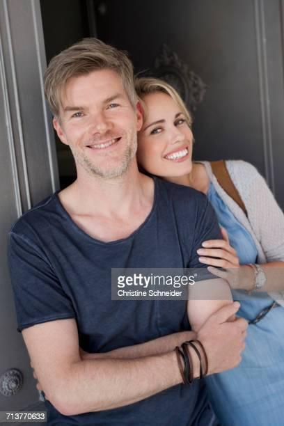 Portrait of happy couple in doorway