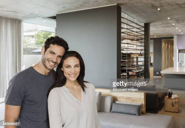 Portrait of happy couple in living room