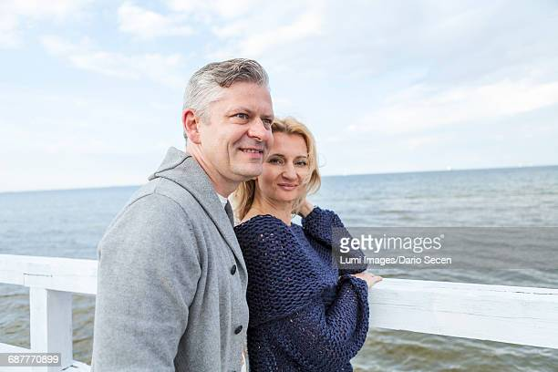 Portrait of happy couple on the waterfront