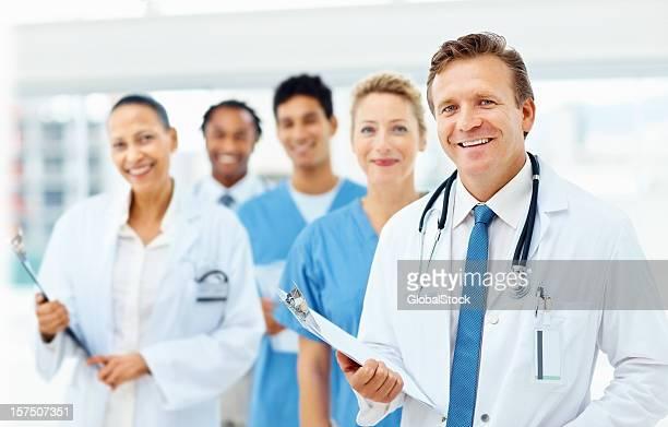 Portrait of happy doctors standing together