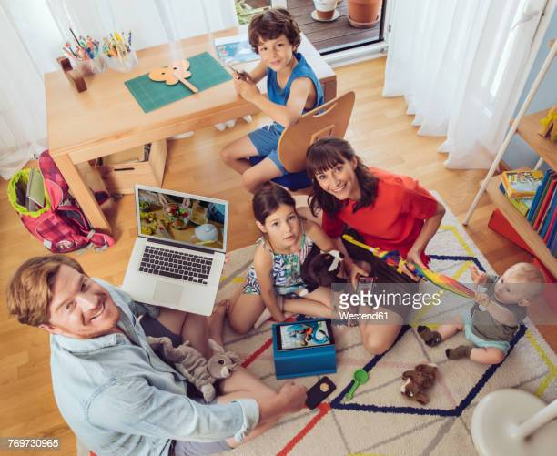Portrait of happy family in childrens room