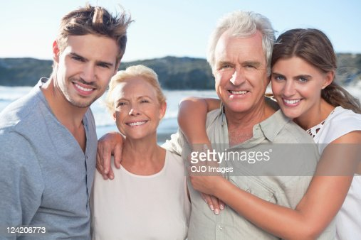 Portrait of happy family smiling on beach