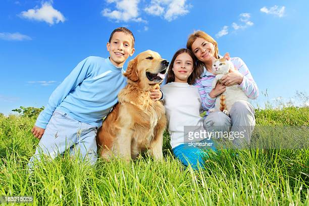 Portrait of happy family with cat and dog.