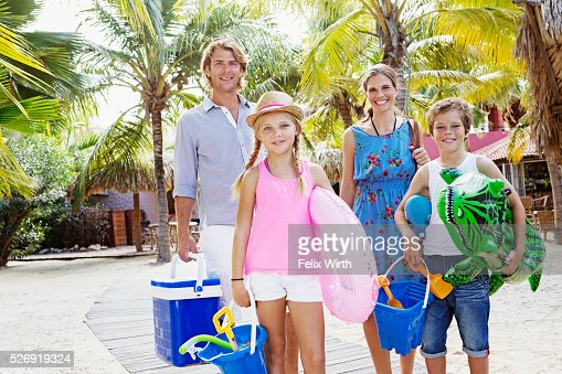 Portrait of happy family with children (10-12) on beach : Foto de stock