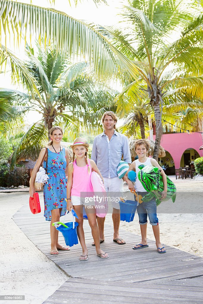 Portrait of happy family with children (10-12) on beach : Stock Photo
