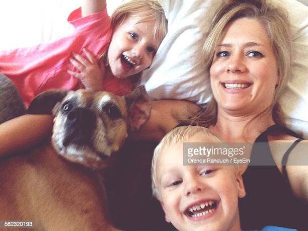 Portrait Of Happy Family With Dog