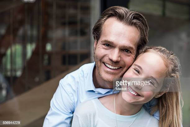 Portrait of happy father and daughter outdoors