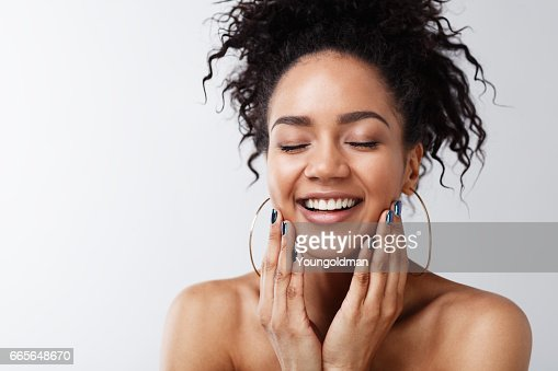 Portrait of happy female with her eyes closed : Foto stock