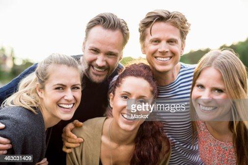 Portrait of happy friends outdoors