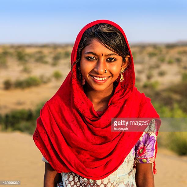 Portrait of happy Indian girl in desert village, India