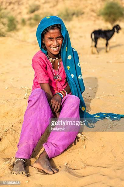 Portrait of happy Indian girl in desert village, India