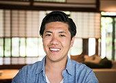 Portrait of happy Japanese man smiling towards camera