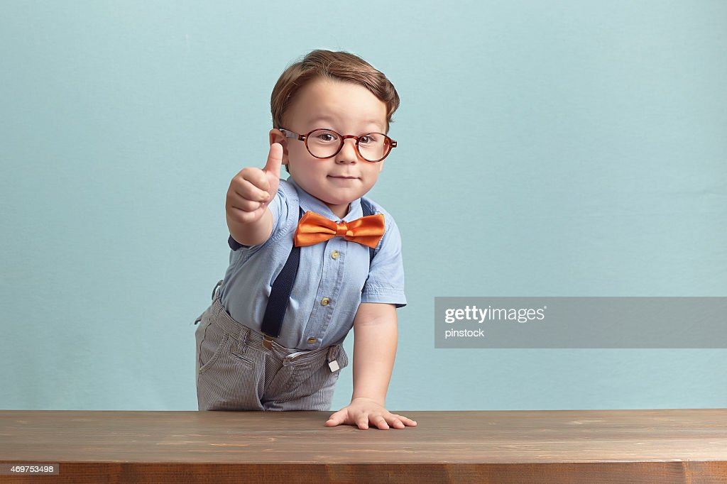 Portrait of happy little boy giving you thumbs up : Stock Photo