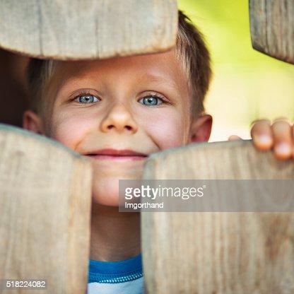 Portrait of happy little boy in the playground