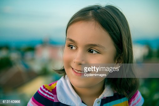Portrait of happy little girl looking away with content smile