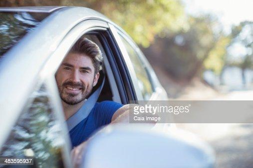 Portrait of happy man driving car