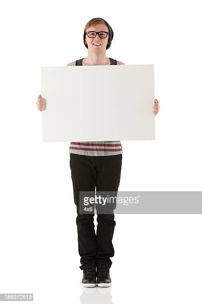 Portrait of happy man holding a placard