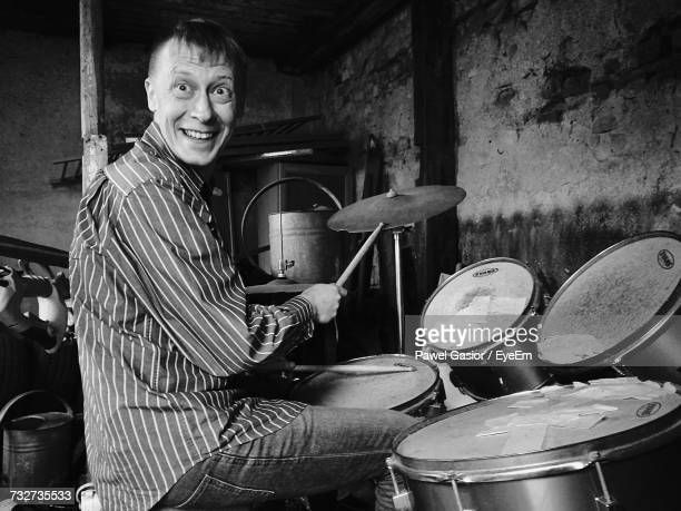 Portrait Of Happy Man Playing Drum