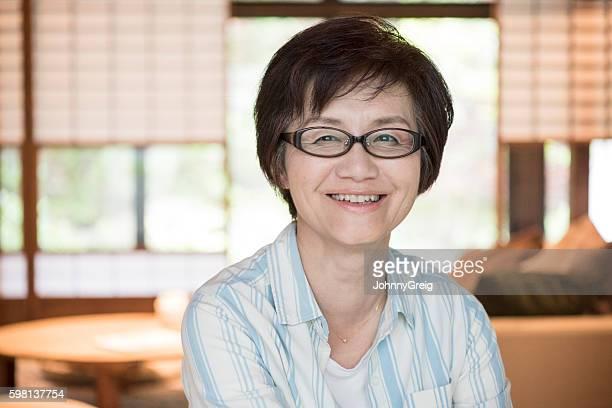 Portrait of happy mature Japanese woman