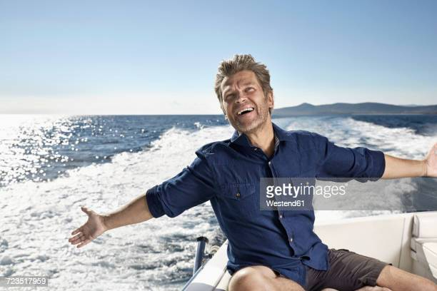 Portrait of happy mature man on his motor yacht