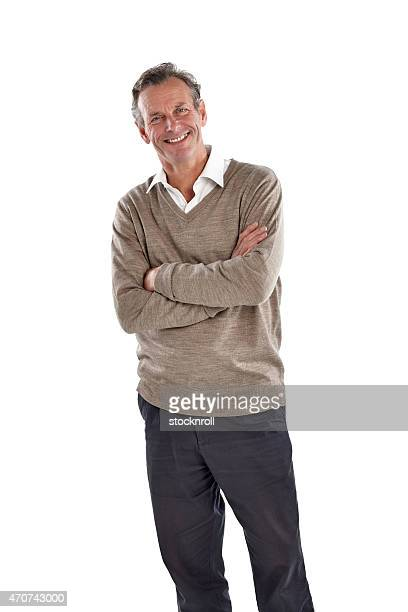 Portrait of happy mature man standing on white