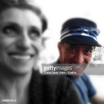 Portrait Of Happy Mature Man With Woman