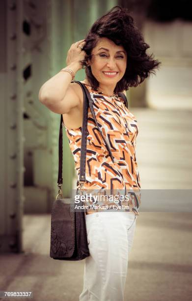 Portrait Of Happy Mature Woman Standing Outdoors
