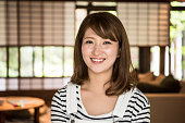 Portrait of happy mid adult Japanese woman