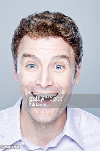Portrait of happy mid adult man, studio shot