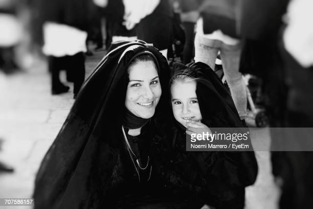 Portrait Of Happy Mother With Daughter In Traditional Clothing