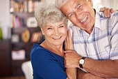 Portrait of happy senior couple in arms