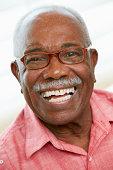 Portrait Of Happy Senior Man At Home