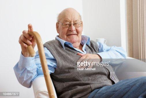 portrait of happy senior man sitting in chair